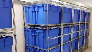 Chrome Wire Compactus with Blue Crates for patient Belongings