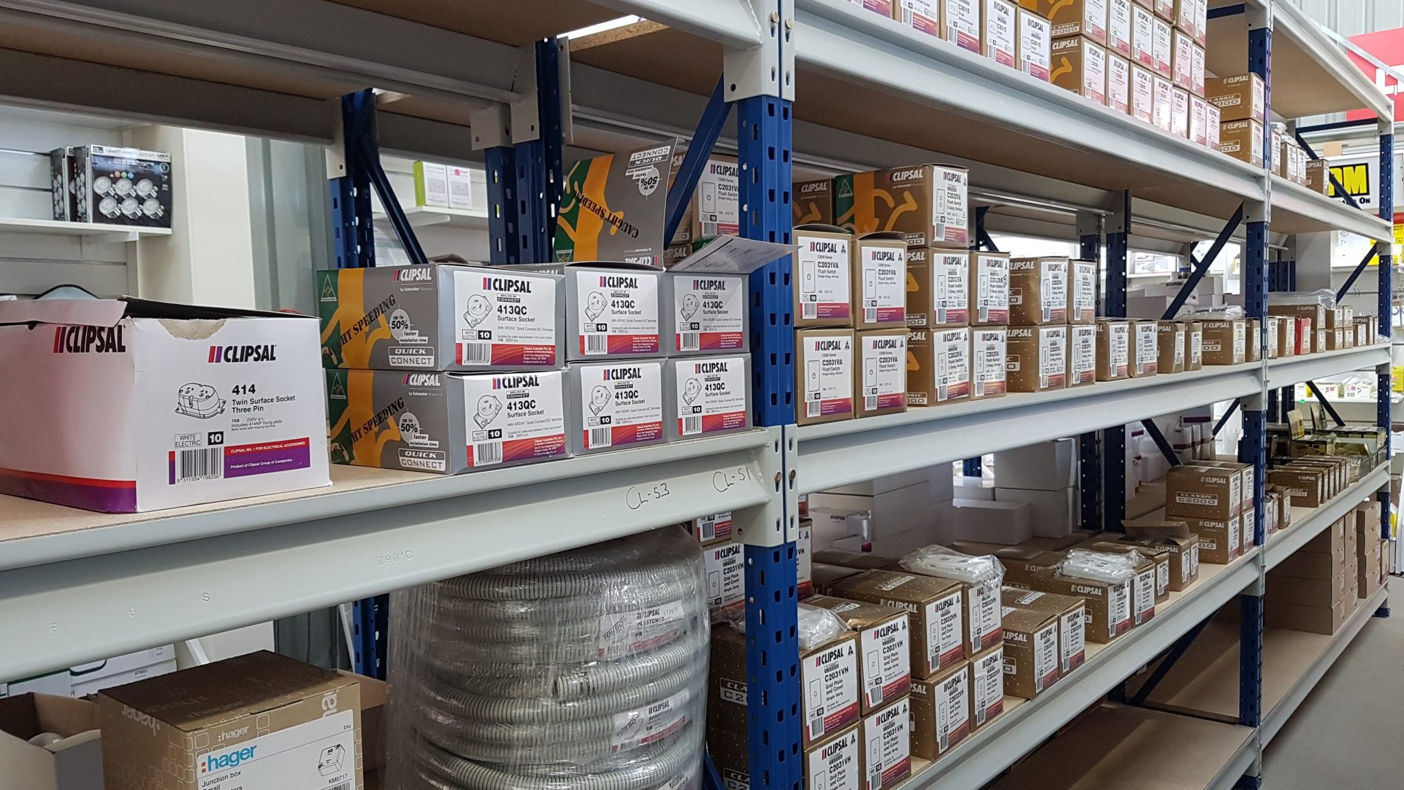 Small boxes of electrical fitting on shelving