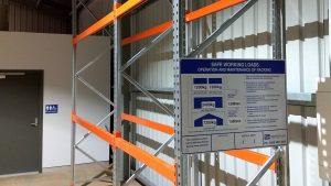 Safe working load sign on pallet racking