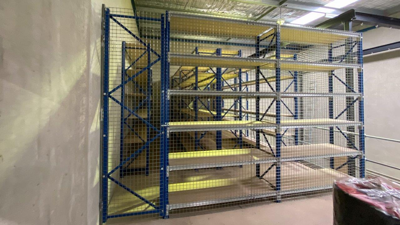 Mesh backing on longspan shelving